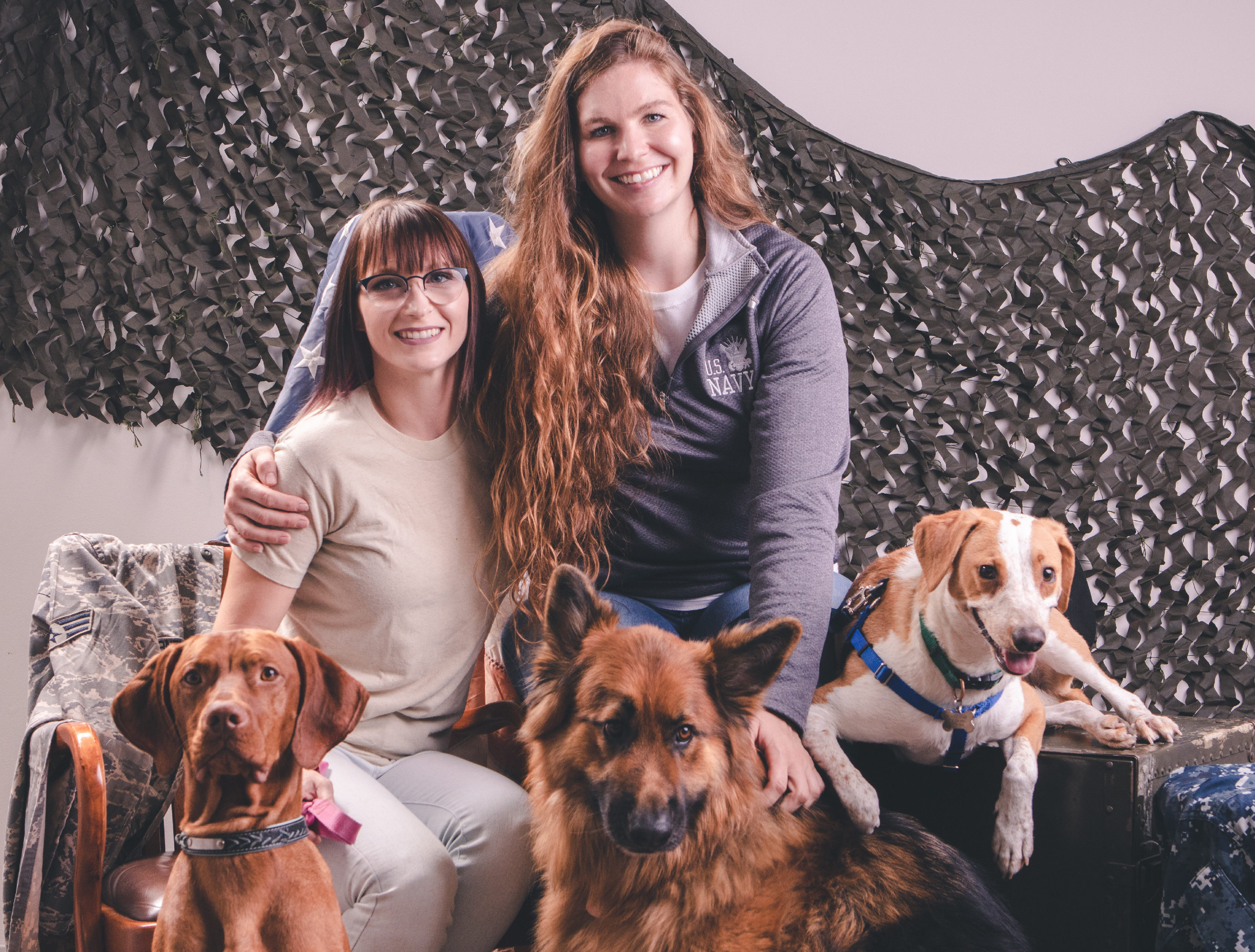 two female veterans with three different breeds of dogs