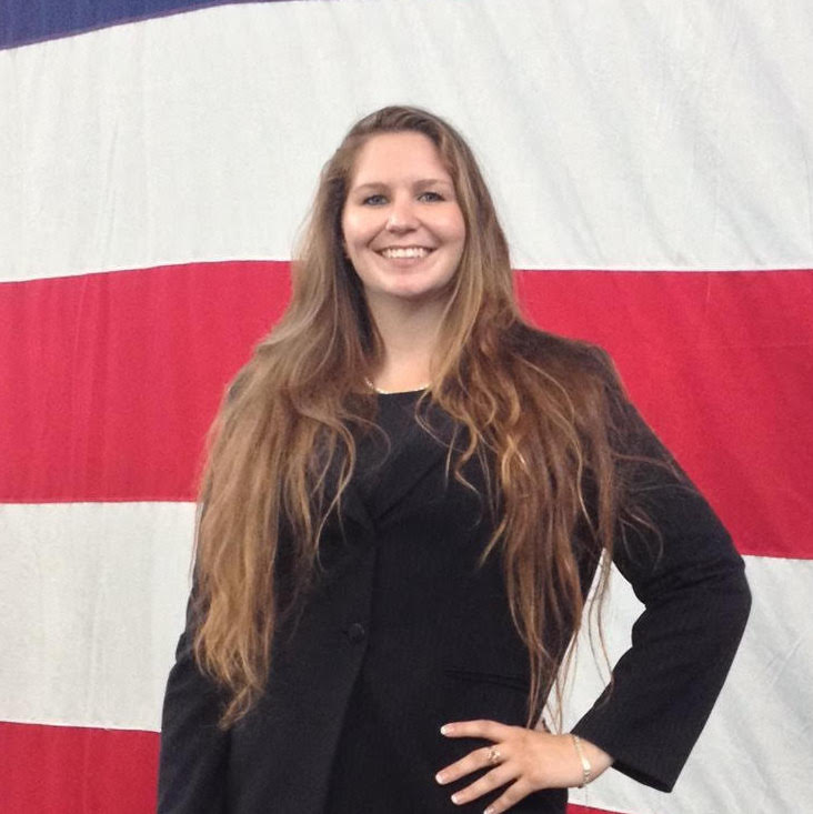 veteran ashley bozeman in front of the american flag